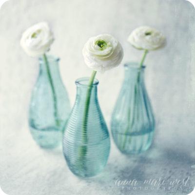 Kukat-lasipullossa